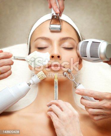 istock Spa Series: Young Beautiful Woman Having Various Facial Treatment. 143920428