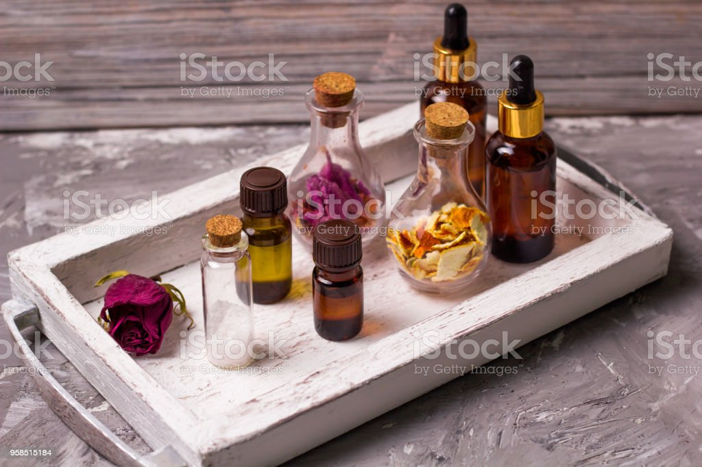 spa set bottles on a vintage wooden tray stock photo