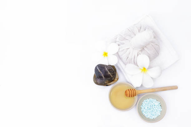 Spa set with honey and sea salt on white background. Beauty and cosmetics concept. stock photo