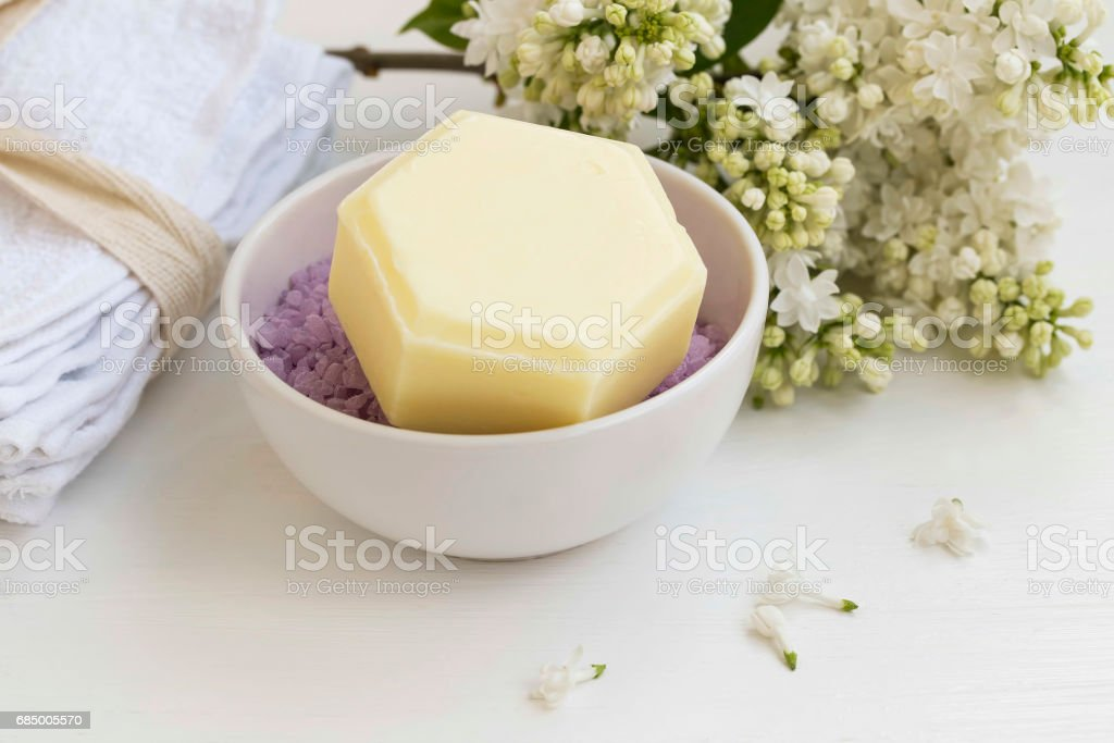 Spa set with honey soap, bath salt and lilac flowers, organic spa products still life setting Lizenzfreies stock-foto
