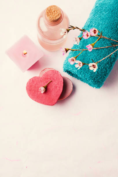 spa setting with towel, soap, waxflowers and candle - spa belgium stock photos and pictures