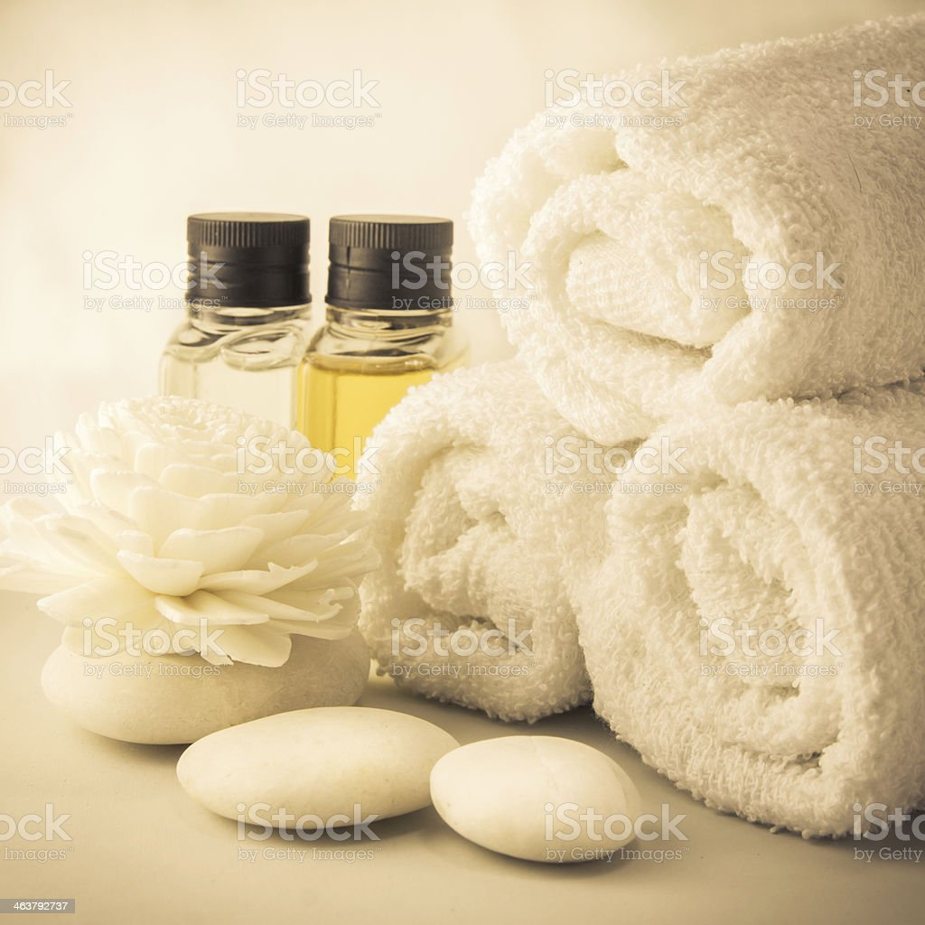 Spa setting with towels in bath room stock photo