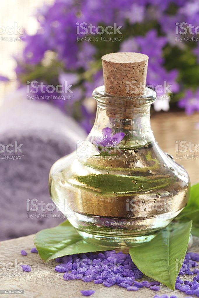 Spa setting with treatment water and flowers royalty-free stock photo
