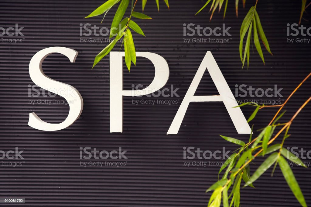 Spa sign on the black wall stock photo