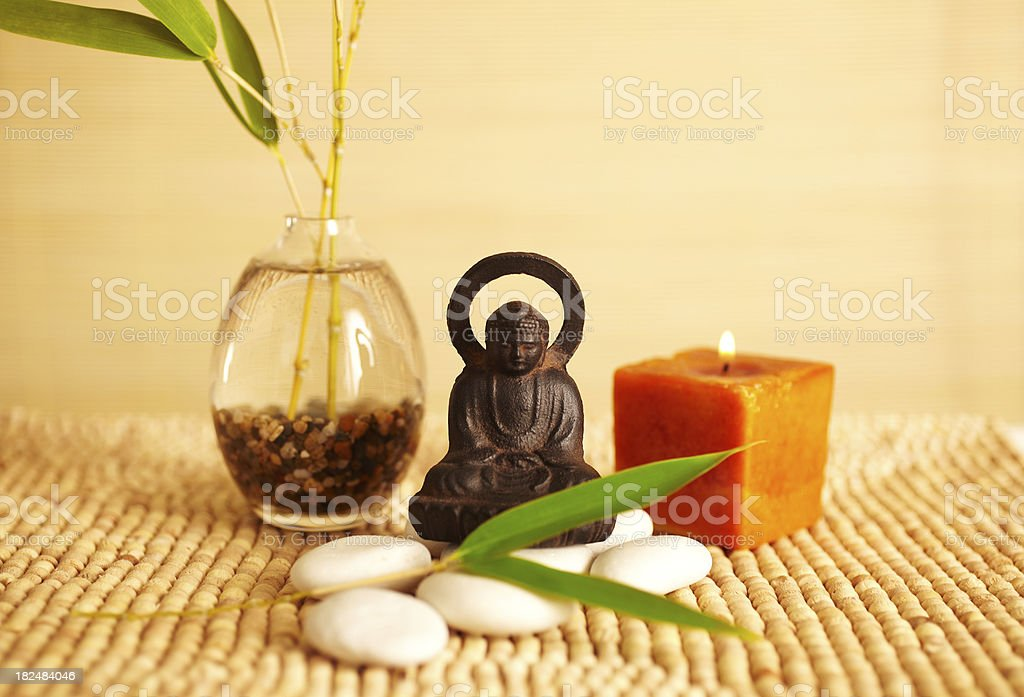 Spa still life buddha statue and candle royalty-free stock photo