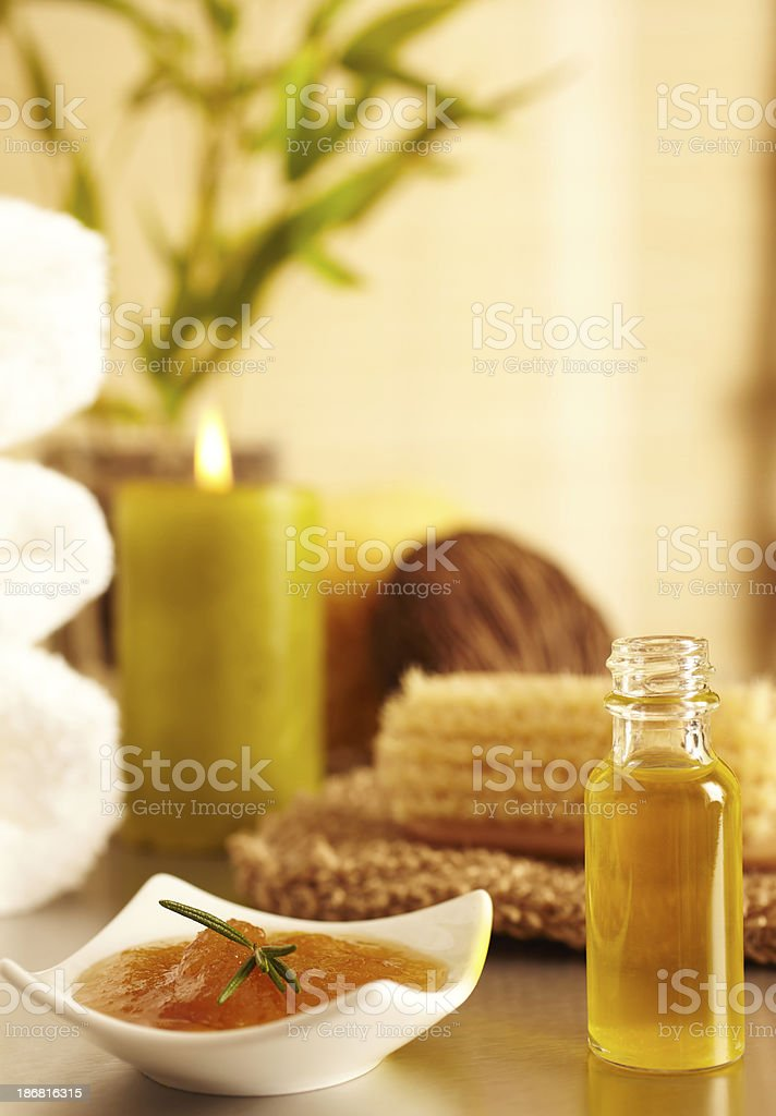 Spa still life honey, candle, essential oil royalty-free stock photo
