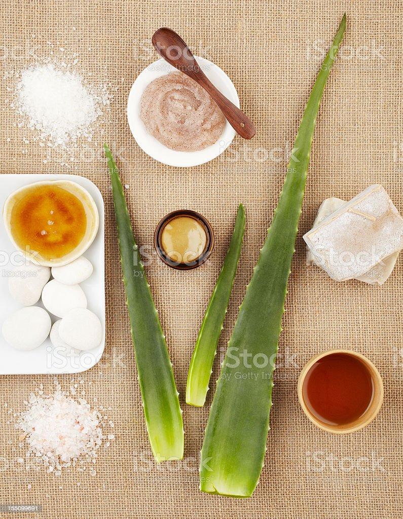 Spa still life with aloe vera, sugar scrub and soap stock photo