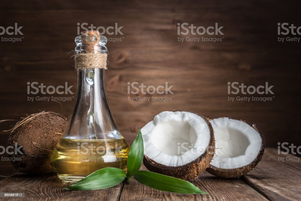 Spa still life with coconut and massage oil stock photo