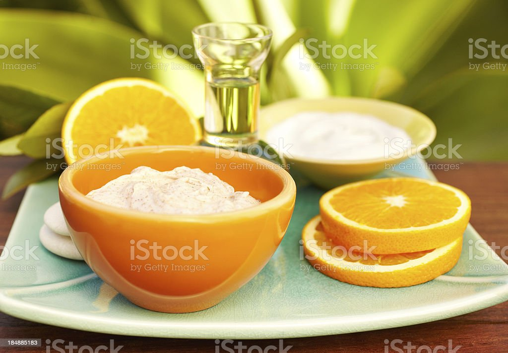 Spa still life with facial mask, oil massage, oranges stock photo