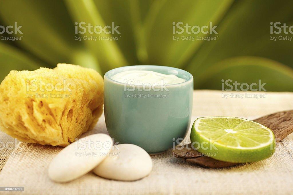 Spa still life with moisturizer and lemon stock photo