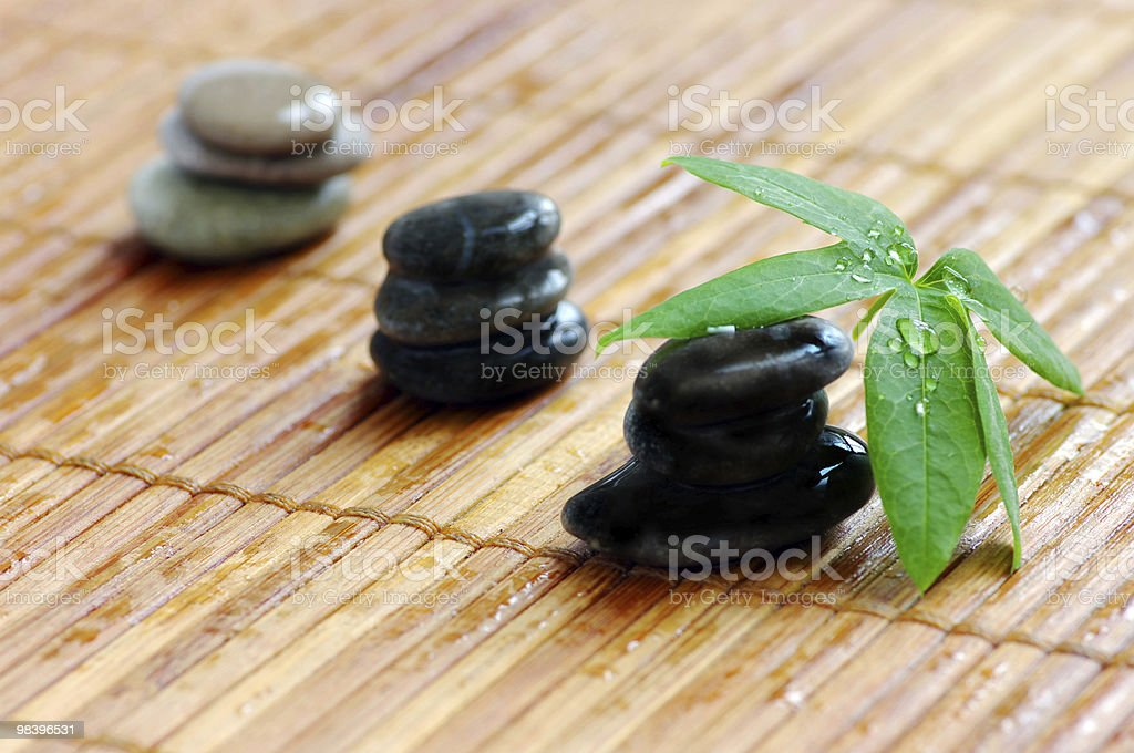 spa stones with green leaf royalty-free stock photo