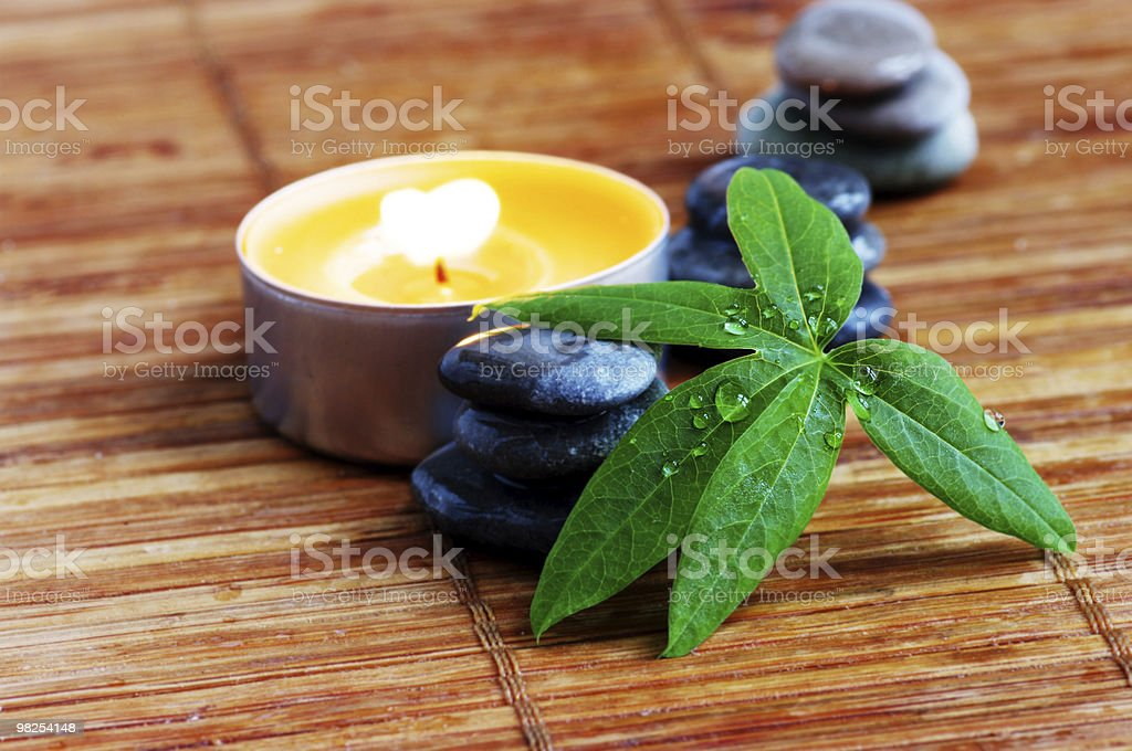 spa stones with leaf and candle royalty-free stock photo