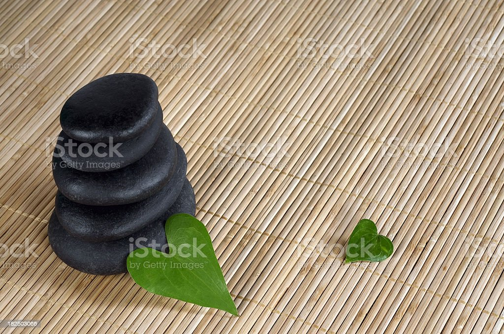 Spa stones with leaves royalty-free stock photo