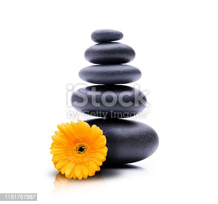 Spa Stones with yellow blossom isolated
