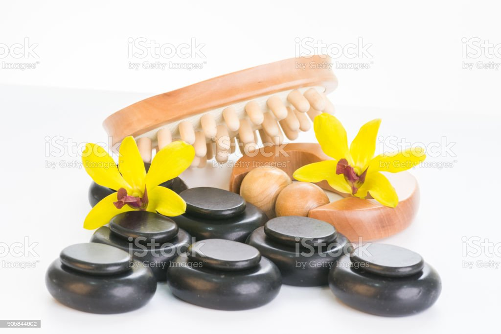 Spa therapy with hot stones, massage roller and cellulite massager stock photo