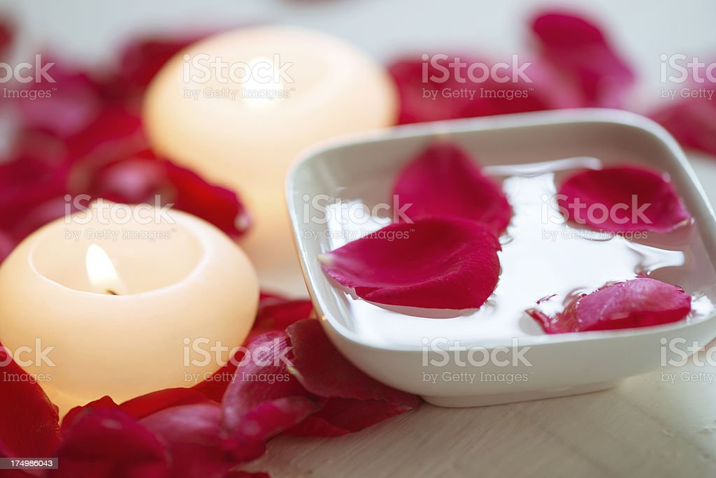 Spa therapy with rose petals royalty-free stock photo