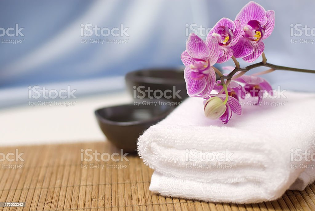 Spa towel withy orchid on Bambu spa stock photo