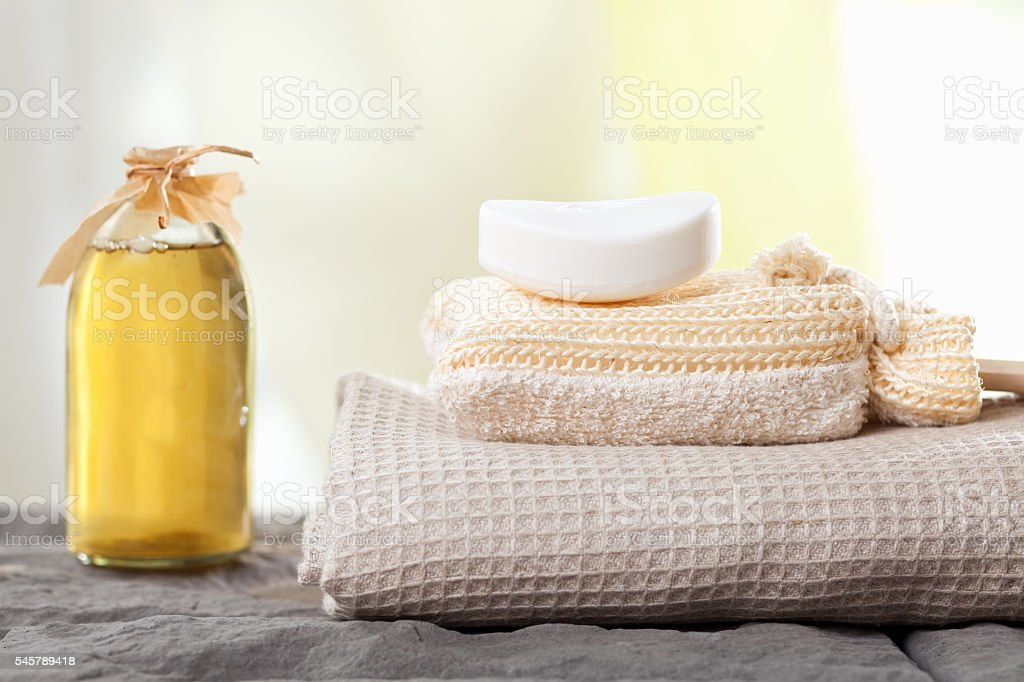 spa towels and aromatic massage oil stock photo