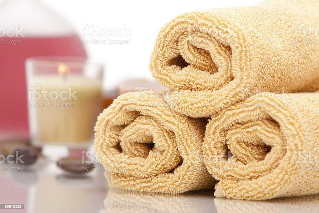 Spa towels, candle and oils royalty-free stock photo