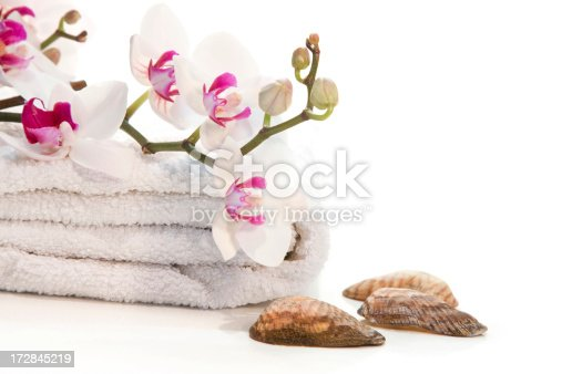 1175869940 istock photo Spa towels, orchid and seashells 172845219