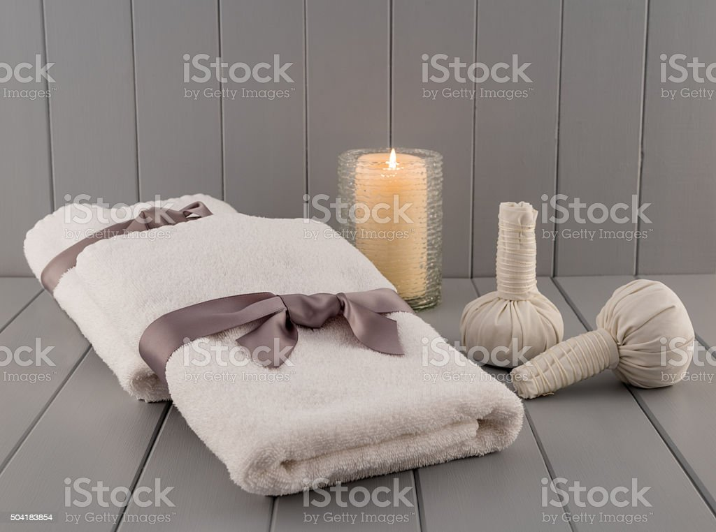 Spa Towels with Thai Massage Balls and Candle stock photo