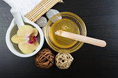 Beauty and spa treatment essentials on a dark wooden background
