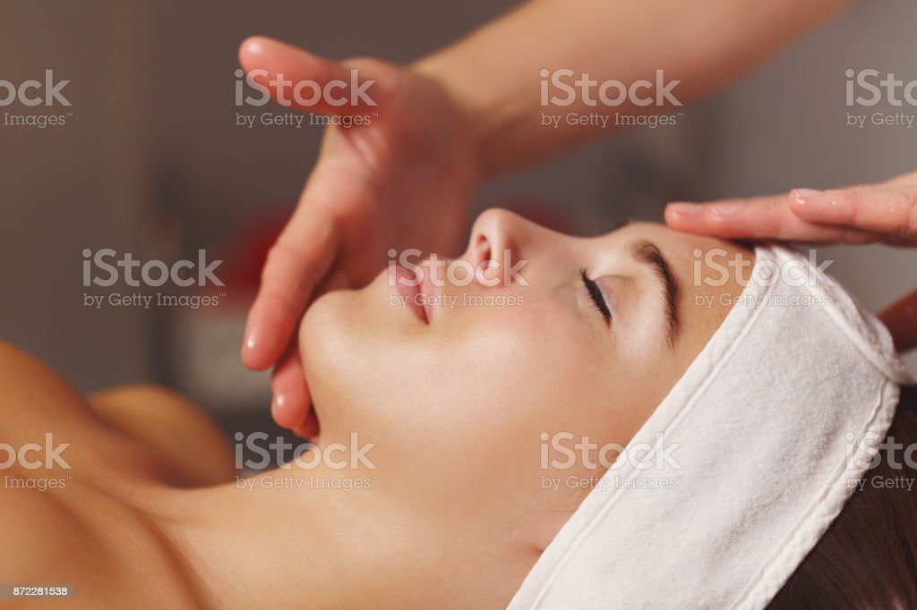 Spa treatment. Face massage stock photo