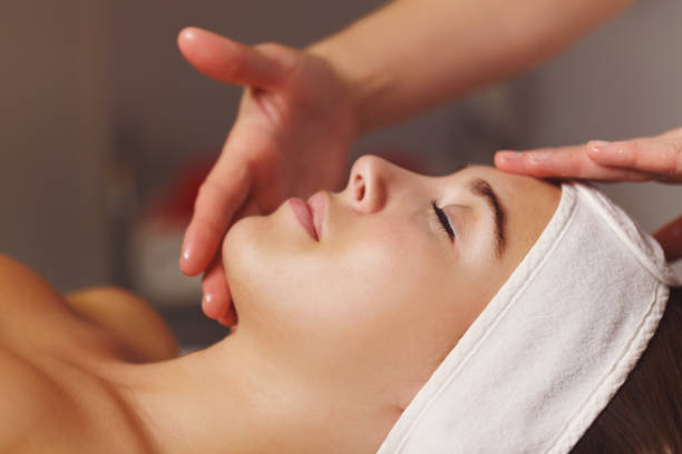 spa treatment. face massage - spa treatment stock photos and pictures