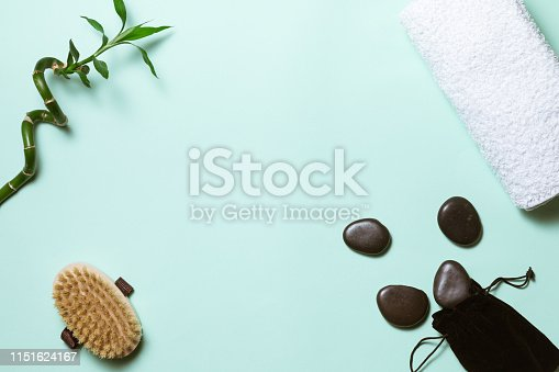 Spa treatment on green blue background, flat lay. Top view of beauty bath background for body care and wellness