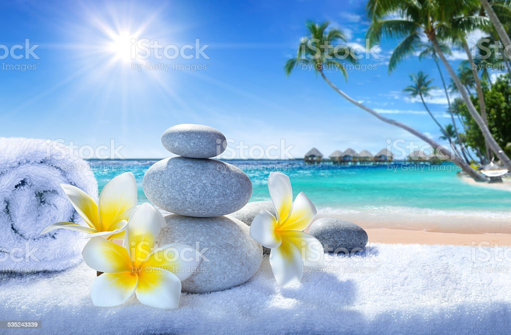 spa treatment on tropical beach stock photo