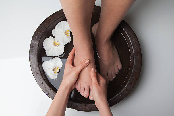 Spa Treatment Foot spa treatment foot massage stock pictures, royalty-free photos & images