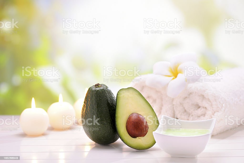Spa Treatment with avacado cream stock photo