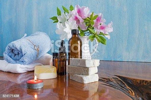 459851883 istock photo Spa treatments on wooden table blue background 524171438