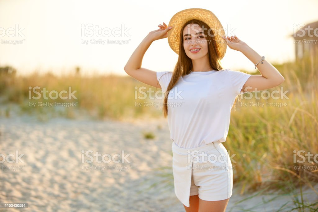 Spa wellness beach beauty woman relaxing and sun bathing on beach in...