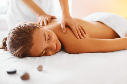 Spa Woman Female Enjoying Massage In Spa Centre Stock Photo - Download Image Now