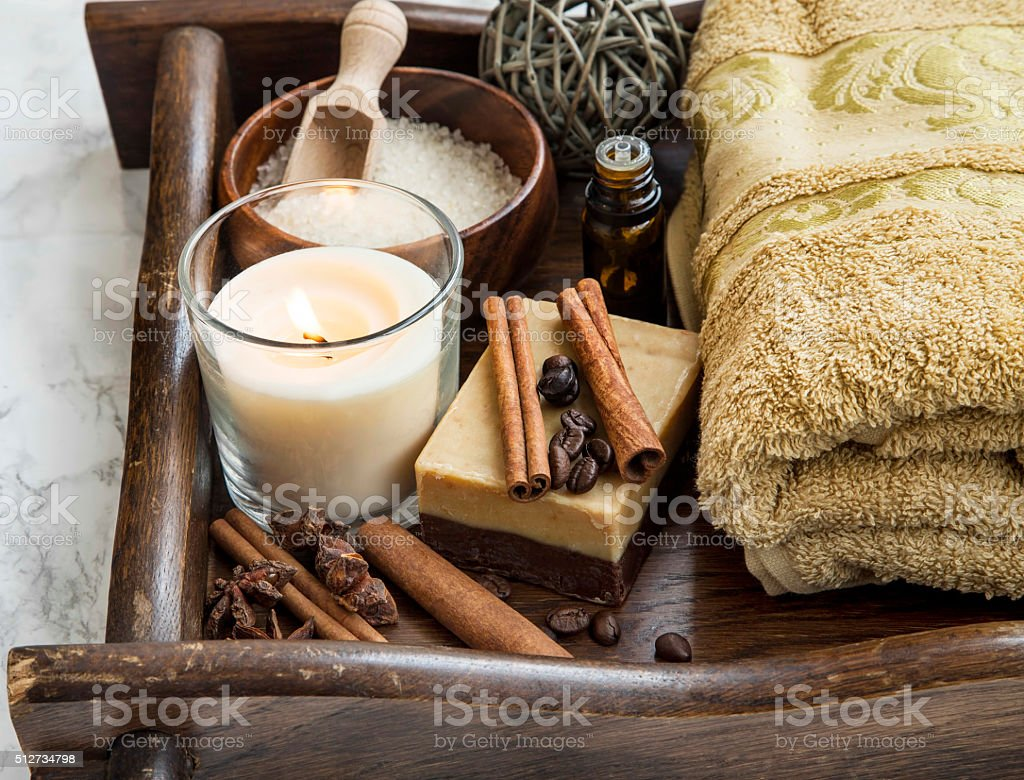 Spa-care products with coffee and cinnamon soap, towel and candl stock photo