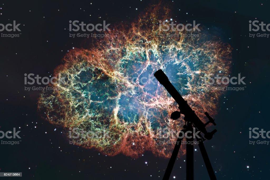 Space background with silhouette of telescope. Crab Nebula in constellation Taurus. Supernova Core pulsar neutron star. stock photo