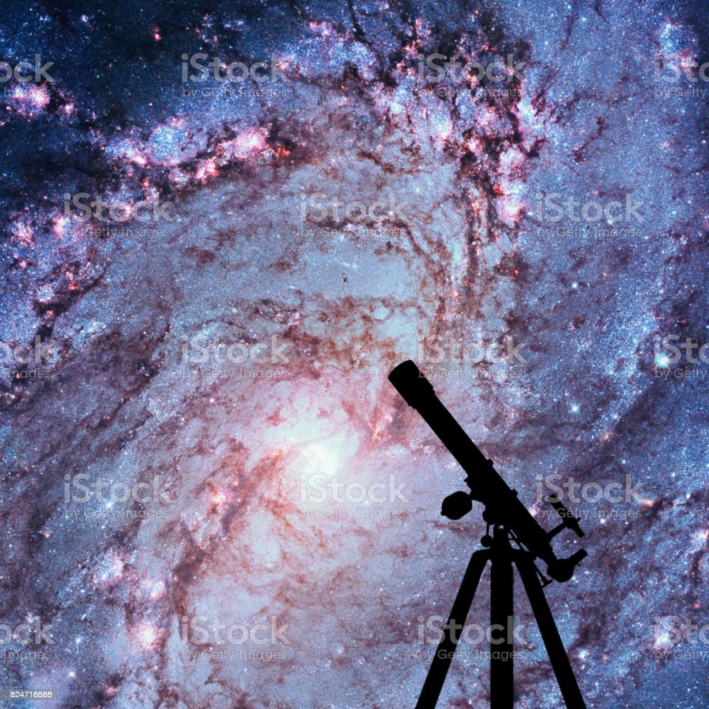 Space background with silhouette of telescope. Messier 83, Southern Pinwheel Galaxy, M83 in the constellation Hydra. stock photo