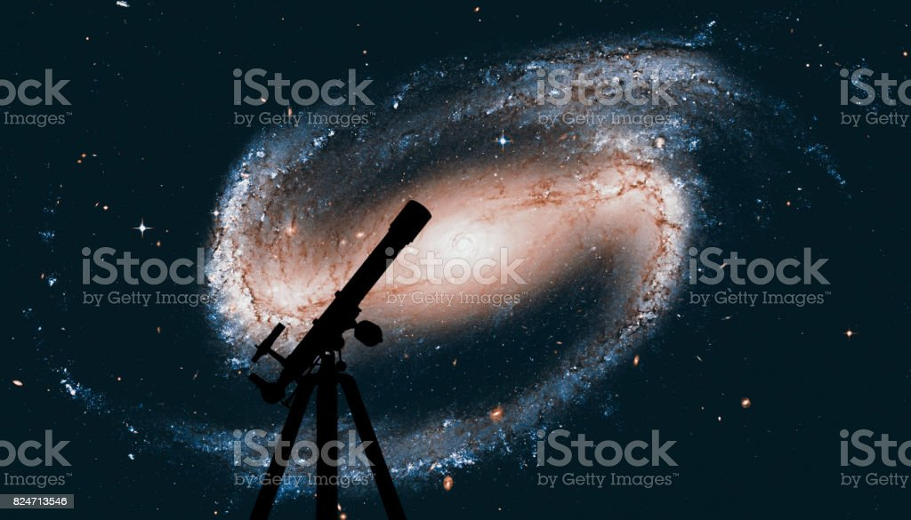 Space background with silhouette of telescope. Spiral galaxy in the constellation Eridanus NGC 1300 stock photo