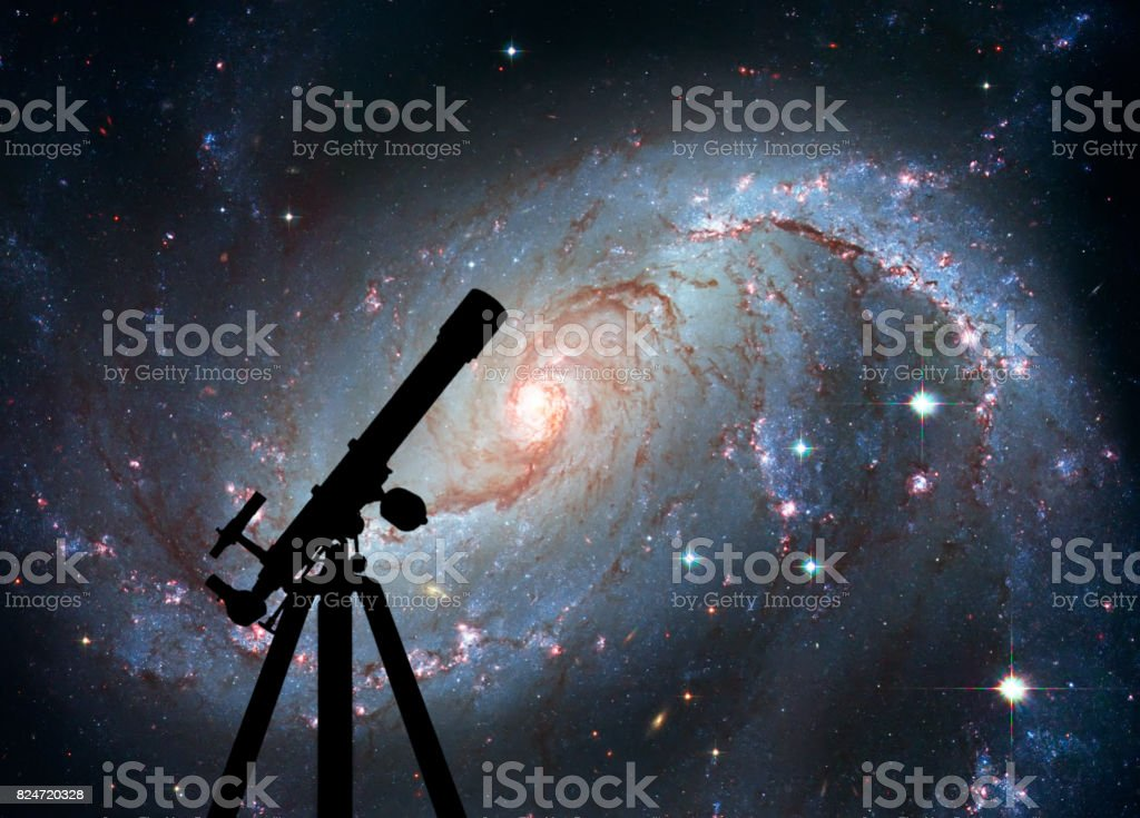 Space background with silhouette of telescope. Stellar Nursery NGC 1672. Spiral galaxy in the constellation Dorado stock photo