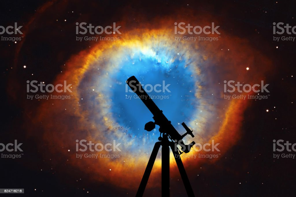 Space background with silhouette of telescope. The Helix Nebula or NGC 7293 in the constellation Aquarius. stock photo