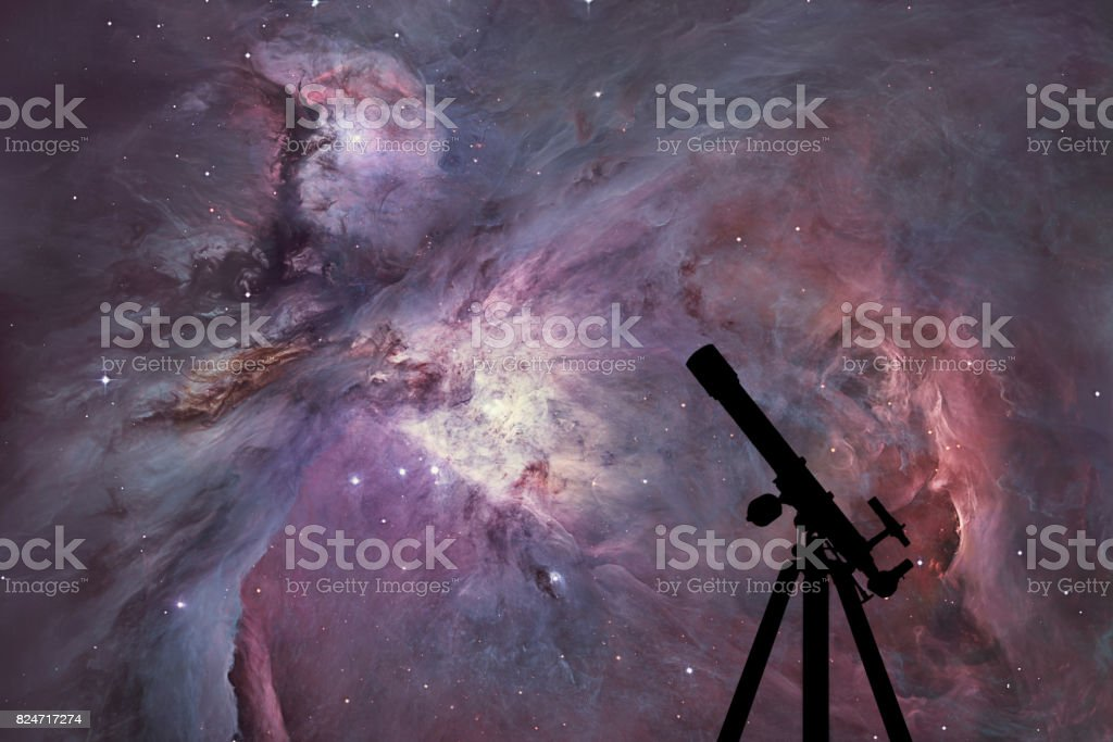 Space background with silhouette of telescope. The Orion Nebula Messier 42 diffuse nebula  in constellation Orion. stock photo
