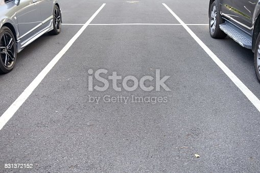 istock space between cars in parking lot 831372152