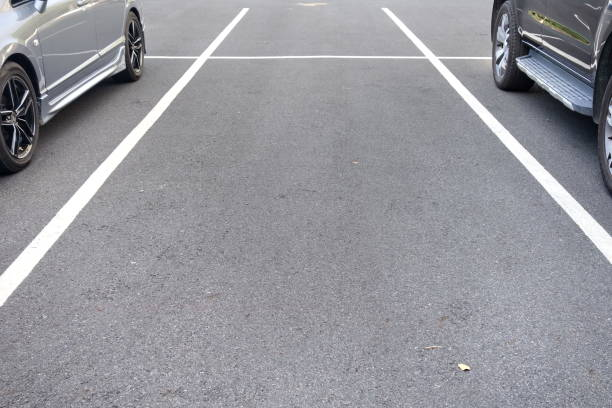 space between cars in parking lot stock photo