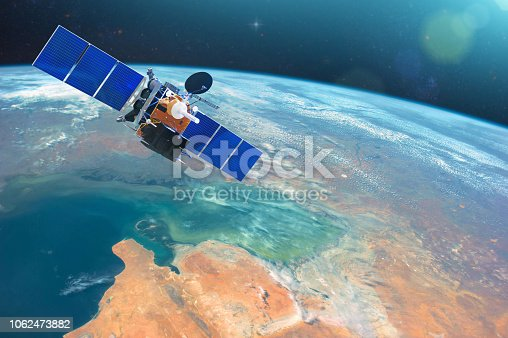 istock Space communications satellite in low orbit around the Earth. Elements of this image furnished by NASA. 1062473882