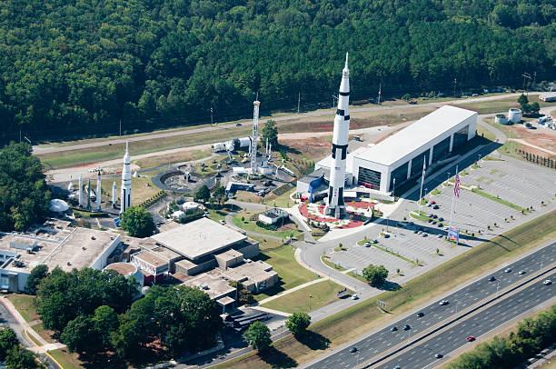 space complex showcasing saturn v rocket - alabama stok fotoğraflar ve resimler