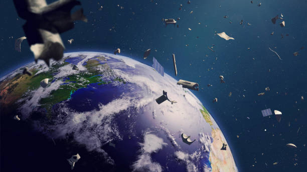 débris spatiaux en orbite terrestre, indésirable dangereux en orbite autour de la planète bleue - détritus photos et images de collection