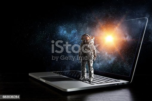 istock Space explorer and laptop. Mixed media 683536284