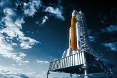 Space Launch System On Launchpad Over Background Of Sky. 3D Illustration. NASA Images Not Used.