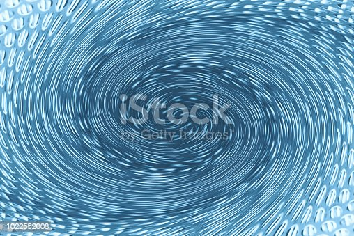 istock Space matter revolves around a spiral wormhole of blue color. Fantastic background image of asymmetric vortex tunnel in center of shot. 1022552008